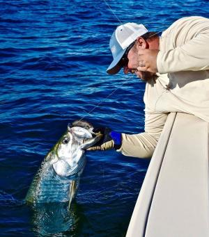 Capt. Jay Withers reels in a tarpon