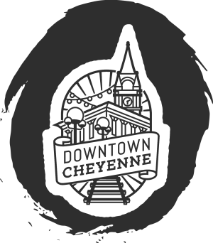 A black circle with the silhouette of a city and text that reads, Downtown Cheyenne