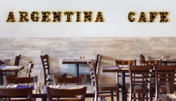 The Argentina Cafe offers guests a casual dine-in empanada experience with tables and chairs.