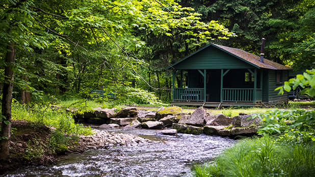 A cabin along a stream in Allegany State Park