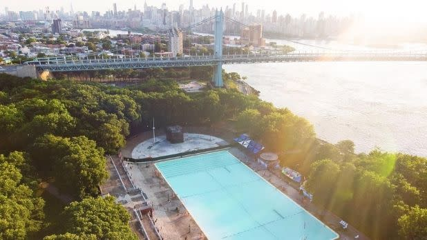 A pool with the Manhattan skyline in the background