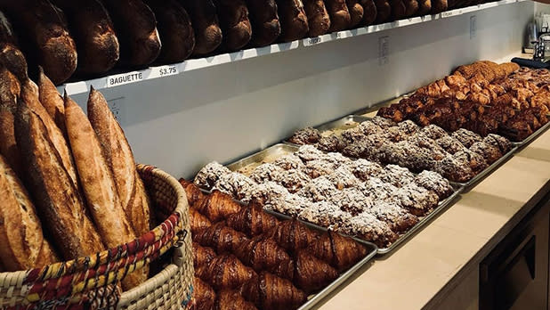 Baguettes and pastries on display