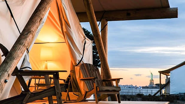 A glamping tent with a view of the Statue of Liverty