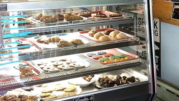 A deli case filled with cookies and pastries