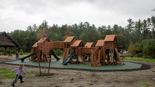 A child runs toward the playground at Frontier Town
