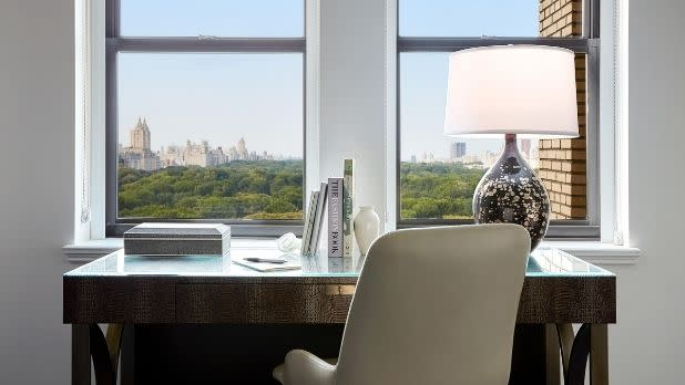 A desk at a window overlooking Central Park at JW Marriott Essex House