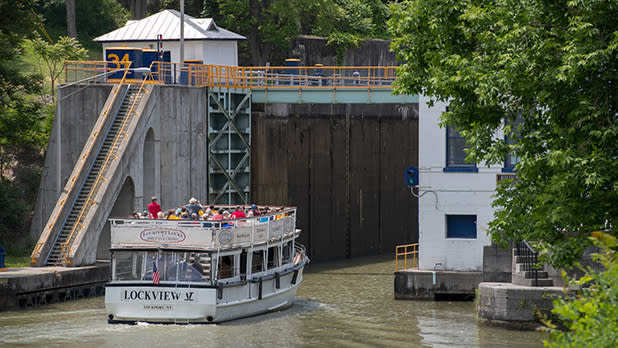 A boat approaches a lock on the Erie Canal
