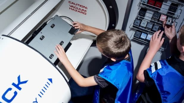 Two children enjoy an activity at the Museum of Innovation and Science