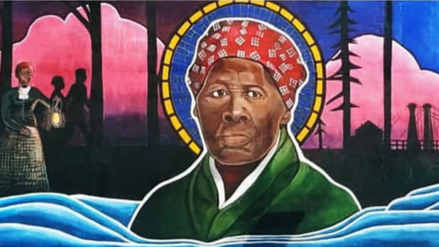 A mural depicting Harriet Tubman in green dress and red bandana