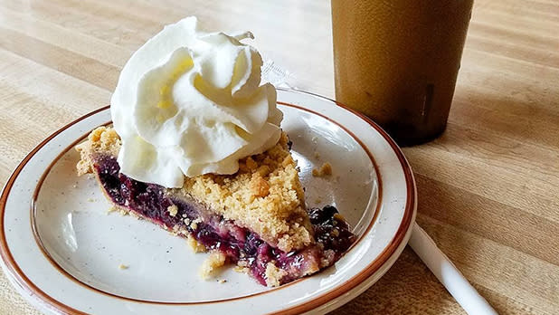Berry pie with whipped cream on top