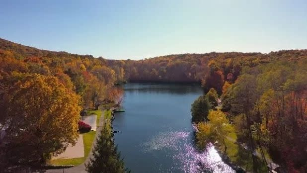 A view of the lake at Rocking Horse Ranch surrounded by fall foliage