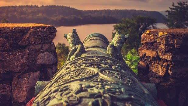 A bronze cannon looking out over Lake Champlain