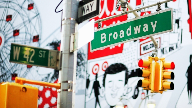 A photo of the Broadway and 42nd street intersection street sign