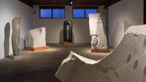 Black and white sculptures in a room at The Noguchi Museum