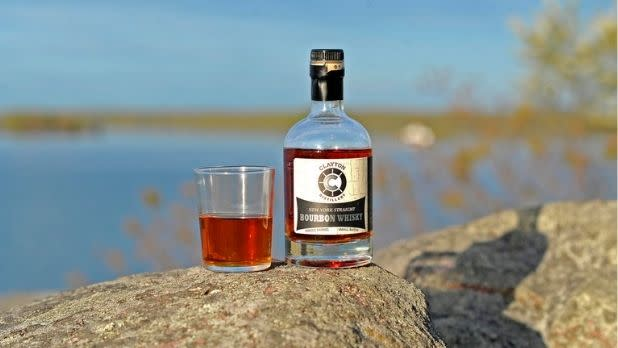 Clayton Distillery, bourbon with a scenic lake background
