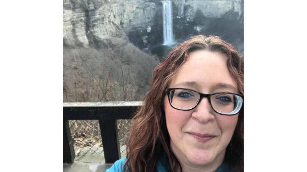 A selfie of Katharine with Taughannock Falls in the background