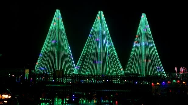 Three Christmas trees made of green lights at Jones Beach
