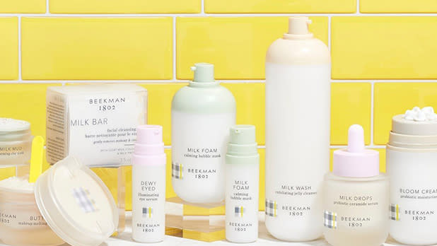 Bottles and containers of Beekman 1802 skincare products
