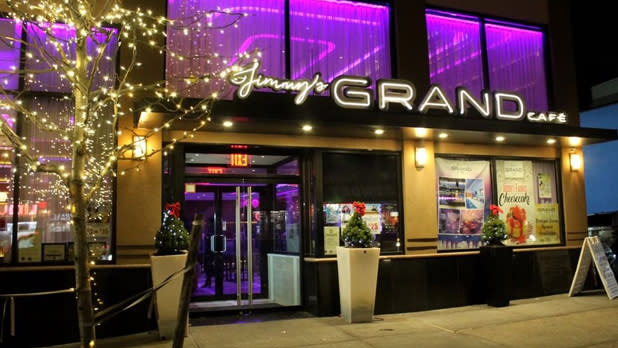 The exterior of Jimmy's Grand Cafe with purple interior lighting visible