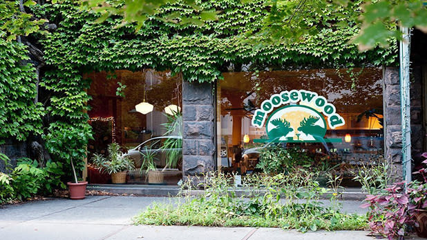 The ivy-covered facade and window featuring the Moosewood restaurant logo