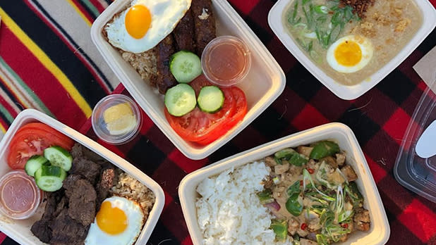 Asian cuisine dishes in to-go containers