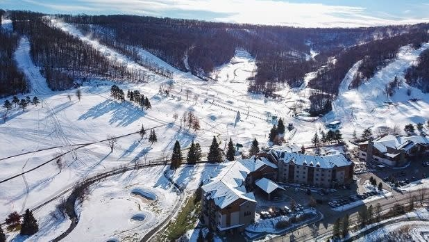 An overhead view of the ski slopes and buildings at Holiday Valley Ski Area.
