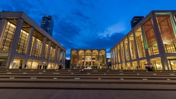A view of three Lincoln Center buildings at night