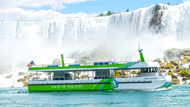 Maid of the Mist electric boats in front of falls; Photo Credit: @niagarafallsadventures on Instagram