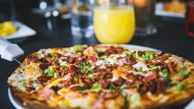 A pizza with toppings at Big Slide Brewery