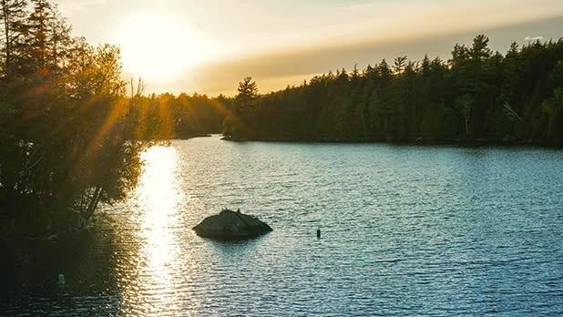 Sun setting over a lake