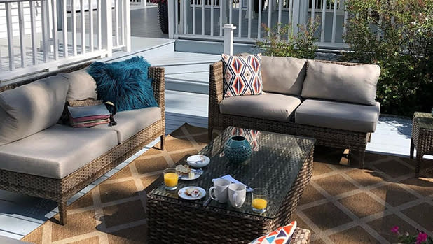 An outdoor area with two sofas and a table