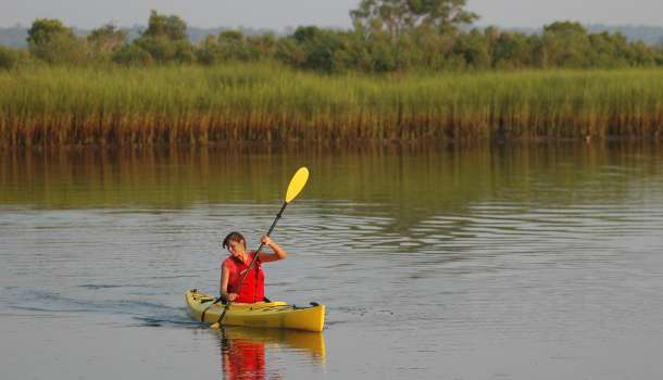 Woman in kayak in salt marsh