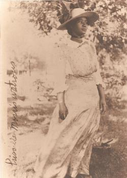 Historic photograph of young woman in turn of the century dress and hat