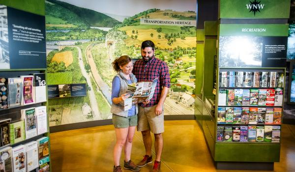 Hikers looking at a map in the Frederick Visitor Center