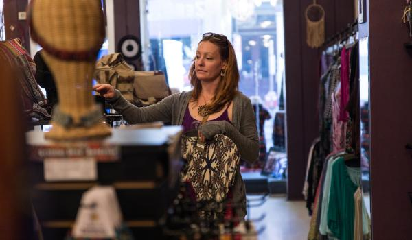 Woman shopping for clothes in a Downtown Frederick boutique
