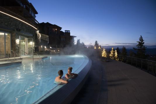 Couple in pool at Stein Eriksen Residence