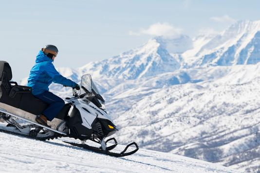 Snowmobiling with Mountain Views