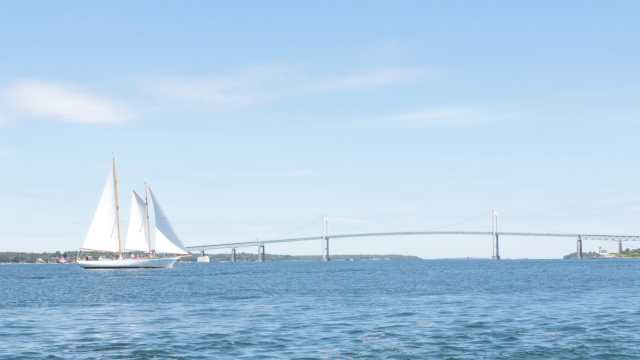 Sailboat in Newport Harbor with Newport Bridge
