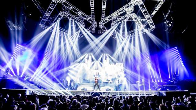 Trans-Siberian Orchestra on stage underneath strobe lights with a full crowd performs at INTRUST Bank Arena in Wichita KS