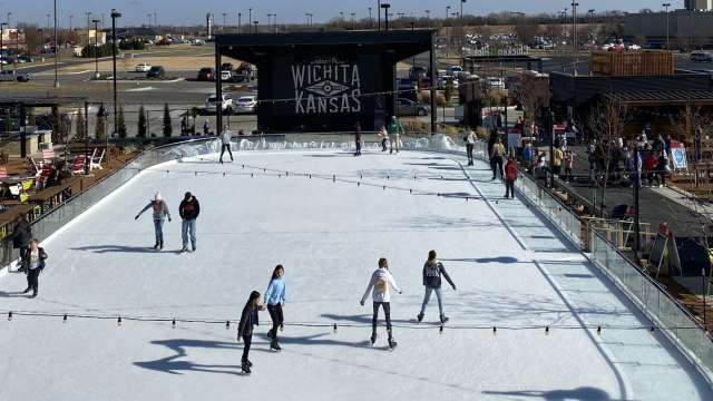 People skate on the ice rink setup at Chicken N Pickle