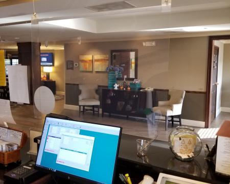 Plexiglass protection at the Staybridge Suites front desk COVID