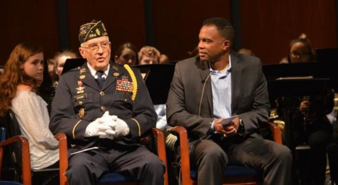 Sydney Barber's father - Ken barber- sits with a retired Army Veteran.