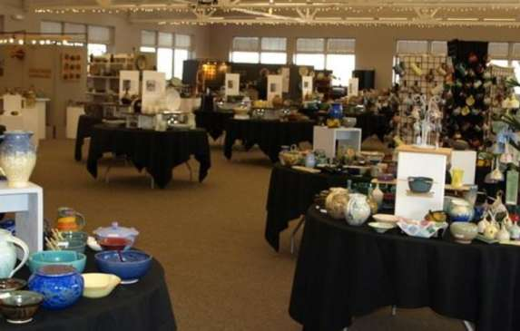 Table displays of art at the Artisan Guilds of Bloomington Holiday Show