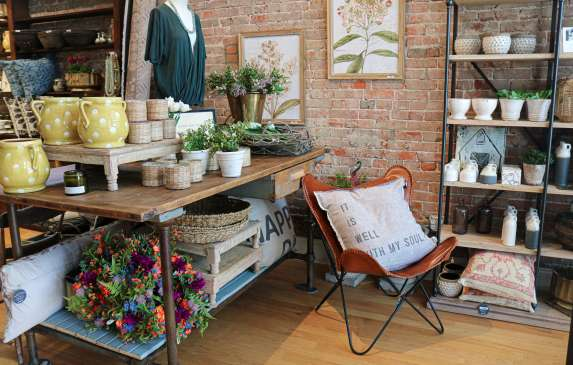 Display of home accents and clothing at Lola + Co.