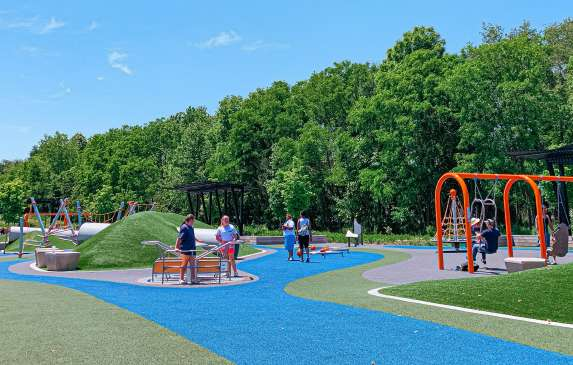 People playing at the Switchyard Park playground