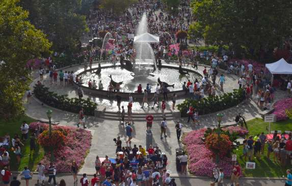 A crowd of people around Showalter Fountain during a First Thursdays event