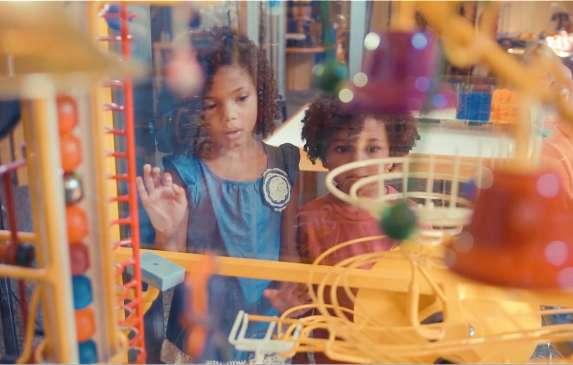 Kids looking at a display at the WonderLab in Bloomington