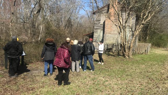 Visitors outside the Superintendent's House on the Dismal Swamp Canal in Chesapeake, VA