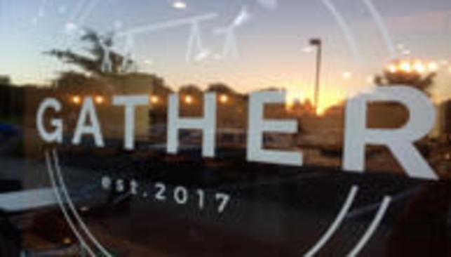 Gather Cafe logo in their storefront window