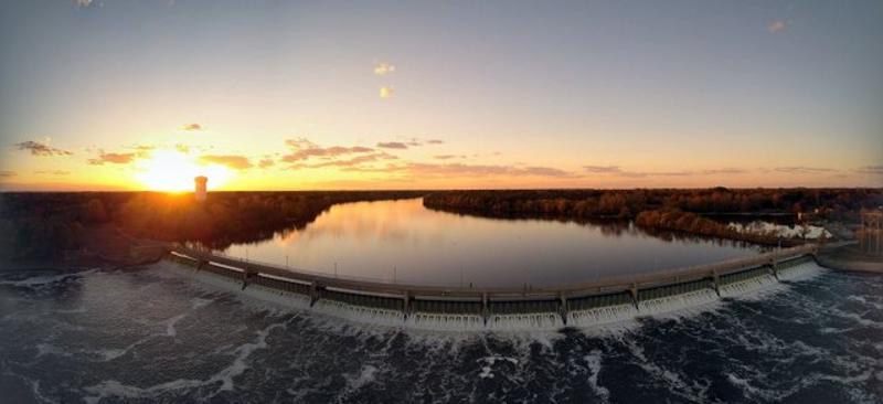 Sunrise over a dam at Mississippi Regional Park